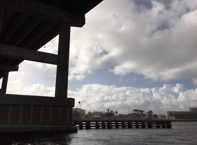 view from under the bridge in rain storm