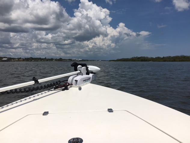 boat river clouds