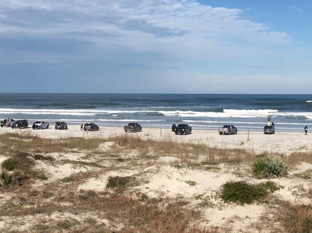 Cars on the beach in January at New Smyrna Beach, Florida