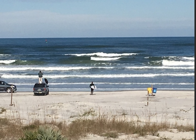 Surfers at New Smyrna Beach, Florida