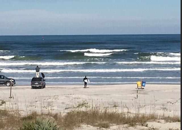 Surfers at New Smyrna Beach, Florida