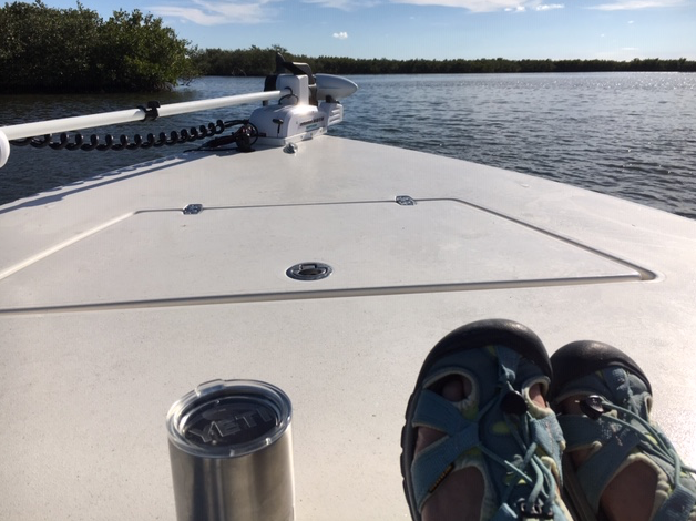Relaxing with my feet up riding in our boat along the Indian River backwaters