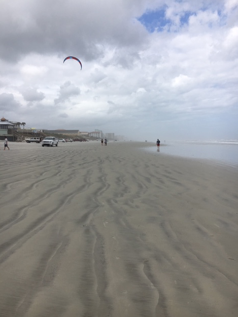 Kite surfer at New Smyrna beach is packing up after surfing.