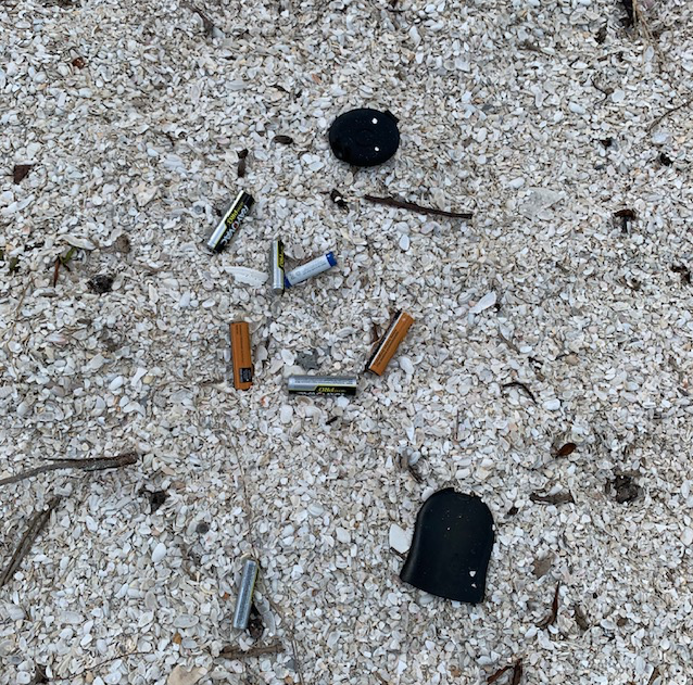 trash batteries in the sand