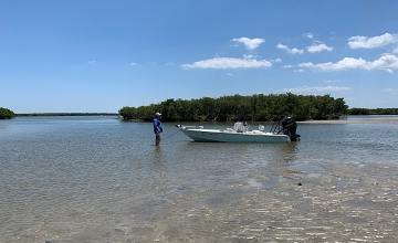 Our boat docked at low tide on the flats