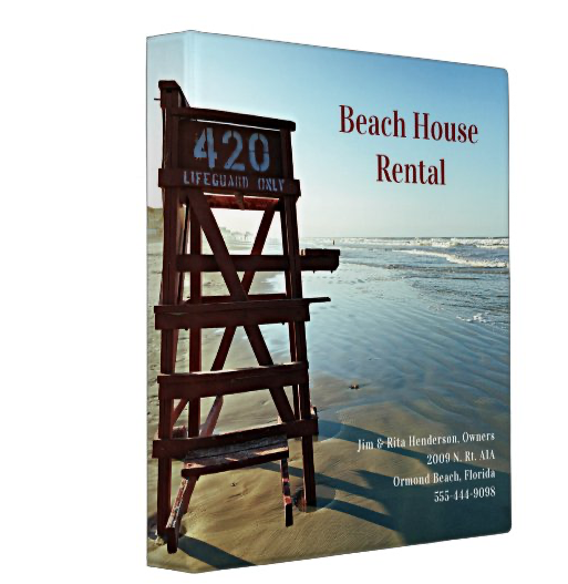 Lifeguard chair edge of sea beach house rental binder