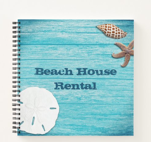 Beach house rental binder with blue wood, seashells and sand dollar design