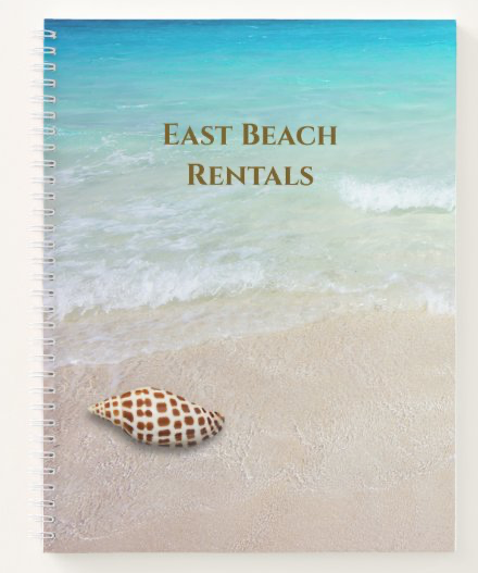 Beach scene notebook with seashell
