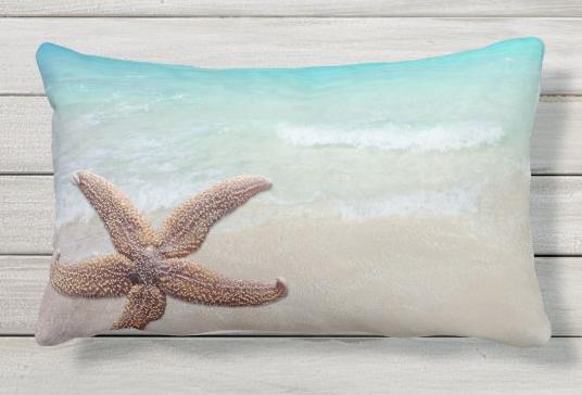 lumbar throw pillow with starfish and beach scene sea sand ocean star