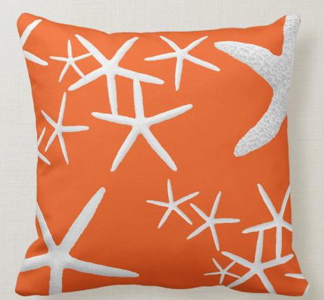 Bright orange tropical starfish pillow